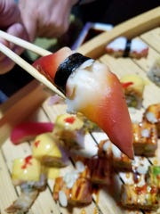 Nigiri sushi with surf clam at Sakura, one of many, many components of our amazing sushi boat.