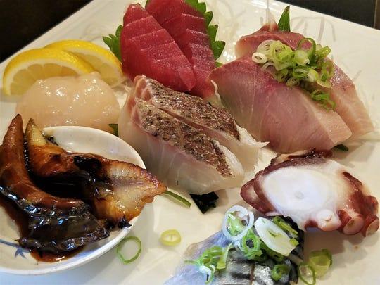 Sashimi at Iwataya. Big, fresh slices of mackerel, cooked eel, octopus, snapper, scallop, tuna and yellowtail.