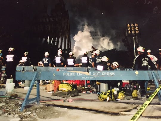 Workers in the search and recovery efforts at Ground Zero in the days after the 9/11 attacks.