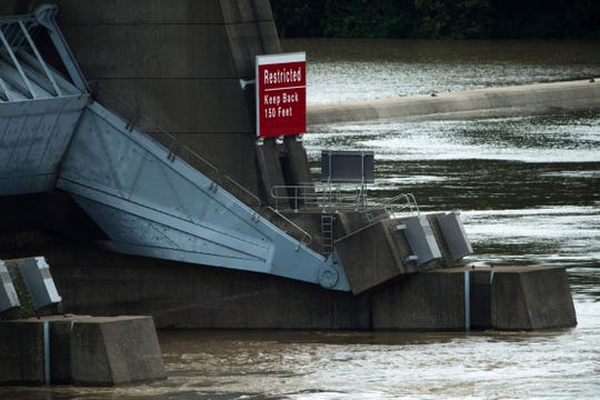 "The gates are open at the Newburgh Dam on the Ohio River as waters continue to rise Monday morning. Steven O. Burks, 45, of Owensboro, Ky., is missing after his fishing boat submerged at the dam as he and a friend, Paul W. Warrenfeltz, 48, also of Owensboro, were catching bait fish Sunday afternoon. Warrenfeltz was able to reach the dam safely. A sign on the dam reads ""Restricted – Keep back 150 feet."""