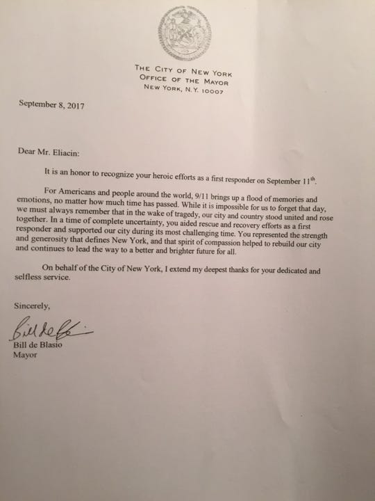 A letter to Paul Eliacin from New York City Mayor Bill de Blasio thanks Eliacin for his service as a volunteer in the rescue efforts after 9/11.
