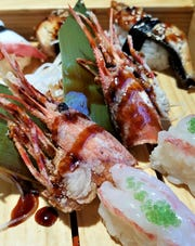 """A fun find at Sakura--fried shrimp heads. You eat the whole crunchy thing except for the """"horn,"""" which makes a great handle."""