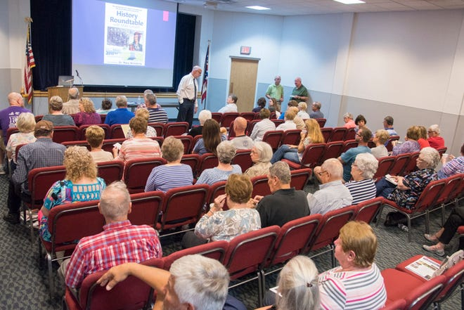 Mike Gilbert speaks to a packed room during a History Roundtable program in fall 2017. His popular series returns this year, starting Saturday.