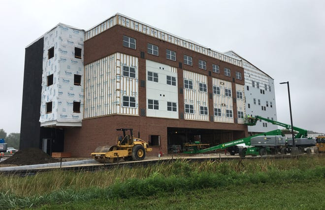 The $19.6 million Landings at Terra Village student housing facility opened on campus Sept. 27 after budget confusion and construction delays.
