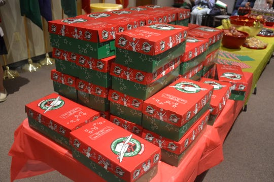 """Operation Christmas Child shoeboxes are lined up at the OCC """"Breakfast in a Box"""" event at Fremont Alliance Church last Saturday. They are a few of the approximately 30,000 shoeboxes that will be filled by Christians in Northwest Ohio this year."""