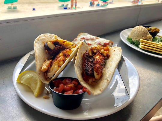 Blackened grouper tacos and a view of the beach from Shucker's at the Gulfshore.