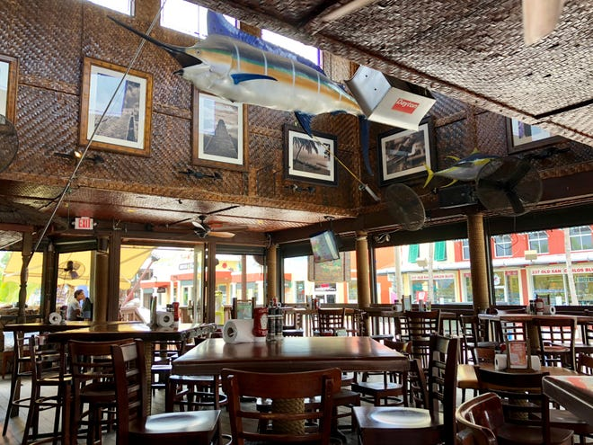 The main dining room was recently empty at Yucatan Beach Stand. Red tide has put a huge dent in spending on Fort Myers Beach.