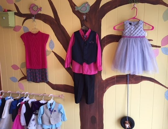 The owners of Klassy Kids Resale in Oconto created a boutique-feel by painting the walls with cute images and adding clotheslines around the store.