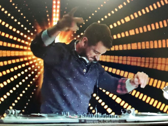 Aaron Rodgers goes full-on DJ in a new spot in his marketing campaign for IZOD.