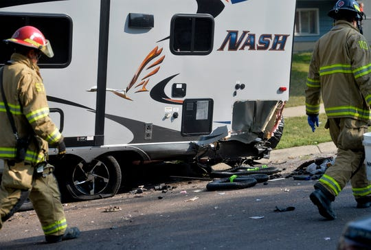 Damaged trailer on 4th Ave South after a speeding car crashed into several parked vehicles on Friday morning, Sept. 7, 2018.