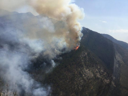 The Brownstone fire burns on the south side of the Brownstone Creek drainage  in the Bob Marshall Wilderness in 2018. Officials briefed Gov. Steve Bullock Tuesday on the upcoming Montana fire season.