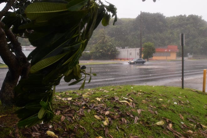 Rain and winds start to pick up during the early stages of Typhoon Mangkhut in Tamuning on Sept. 10, 2018.