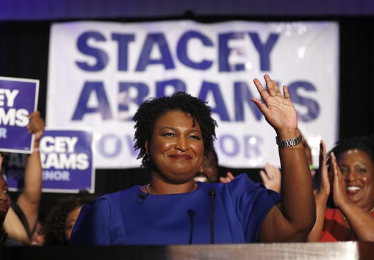 Democrat Stacey Abrams could become the nation's first black female governor if she wins in Georgia in November. Abrams waves to supporters after speaking at a primary election-night watch party on Tuesday, May 22, 2018, in Atlanta.