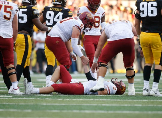 Iowa State quarterback Kyle Kempt is helped to his feet after hurting his knee after being sacked in the fourth quarter against Iowa on Saturday, Sept. 9, 2018, at Kinnick Stadium in Iowa City.