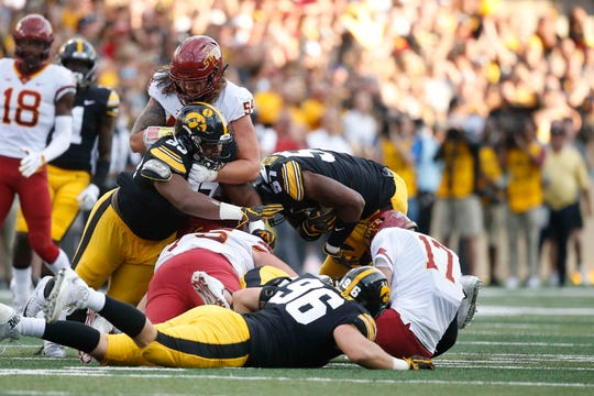 Iowa State quarterback Kyle Kempt crumples after being sacked in the fourth quarter against Iowa on Saturday, Sept. 9, 2018, at Kinnick Stadium in Iowa City.