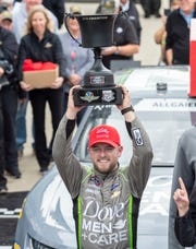 NASCAR Xfinity Series driver Justin Allgaier (7) celebrates after winning the Lilly Diabetes 250 NASCAR XFINITY Series race at Indianapolis Motor Speedway Monday, Sept. 10, 2018.