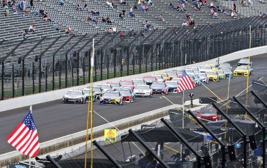 Drivers head down the main straightaway for the green flag at the start of the final stage of the Brickyard 400 at Indianapolis Motor Speedway on Monday, Sept.10, 2018.