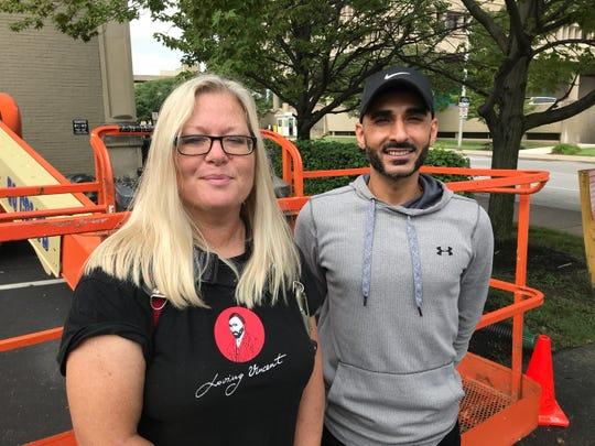Mural artist Pamela Bliss and Jafari Estates managing partner Ben Jafari pose outside the office building at 127 E. Michigan St.