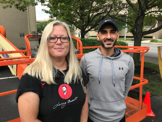 Mural artist Pamela Bliss and Jafari Estates managing partner Ben Jafari pose outside the office building at 127 E. Michigan St.