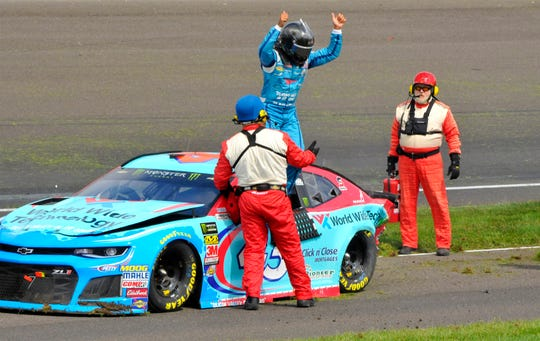 NASCAR Cup Series driver Bubba Wallace (43) gives the thumbs up to tell the fans he's OK after a crash in turn 3 at the Brickyard 400 at Indianapolis Motor Speedway on Monday, Sept.10, 2018.