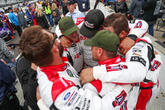 Pit crew members for NASCAR Cup Series driver Ryan Blaney (12) huddle before the 2018 Big Machine Vodka 400 at the Brickyard at Indianapolis Motor Speedway on Monday, Sept. 10, 2018.