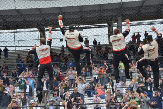 NASCAR Cup Series driver Brad Keselowski (2) and his crew climb the fence after winning the Brickyard 400 at Indianapolis Motor Speedway on Monday, Sept.10, 2018.