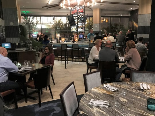 A grand bar centers the 150-seat dining room at Nesso Italian restaurant near Lucas Oil Stadium in downtown Indianapolis.