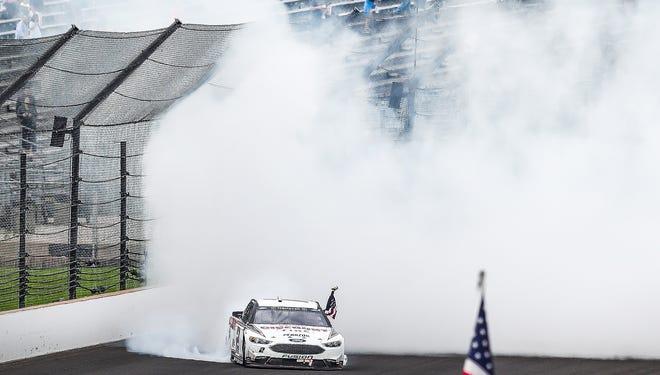 NASCAR Cup Series driver Brad Keselowski (2) celebrates after winning the 2018 Big Machine Vodka 400 at the Brickyard at Indianapolis Motor Speedway on Monday.