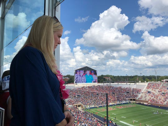 Ashley Luke looks out on Vaught-Hemingway stadium before her husband, coach Matt Luke, and Ole Miss take on Southern Illinois on Sept. 8, 2018.