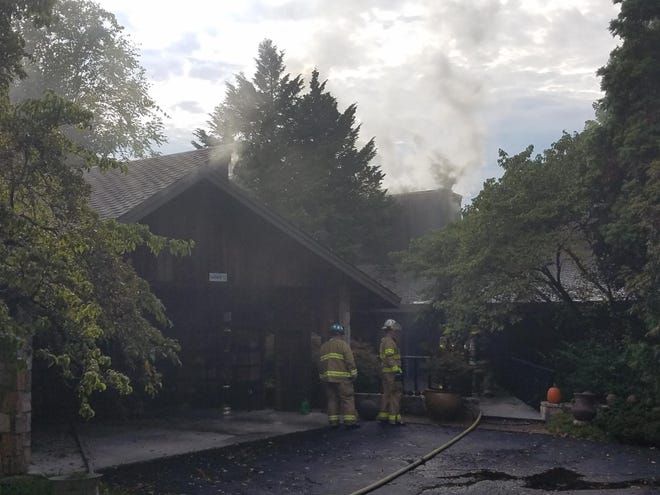 Rural/Metro crews battle a house fire on South Fox Den Drive in Farragut on Sunday, Sept. 9, 2018.