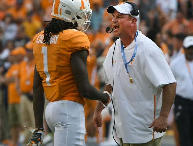 Tennessee Head Coach Jeremy Pruitt catches Marquez Callaway (1) as he comes off the field against East Tennessee State Saturday, September 8, 2018 at Neyland Stadium in Knoxville, Tenn.