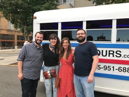 Carey Hodges, second from left, with friends in front of a Knox Brew Tours bus.