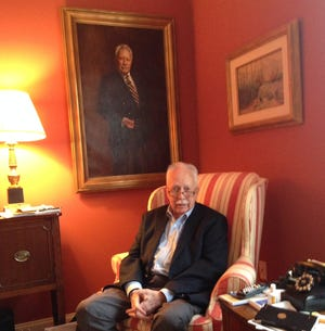Randy Mansfield sits in front of a portrait of himself at his home at Shannondale retirement center in 2014.