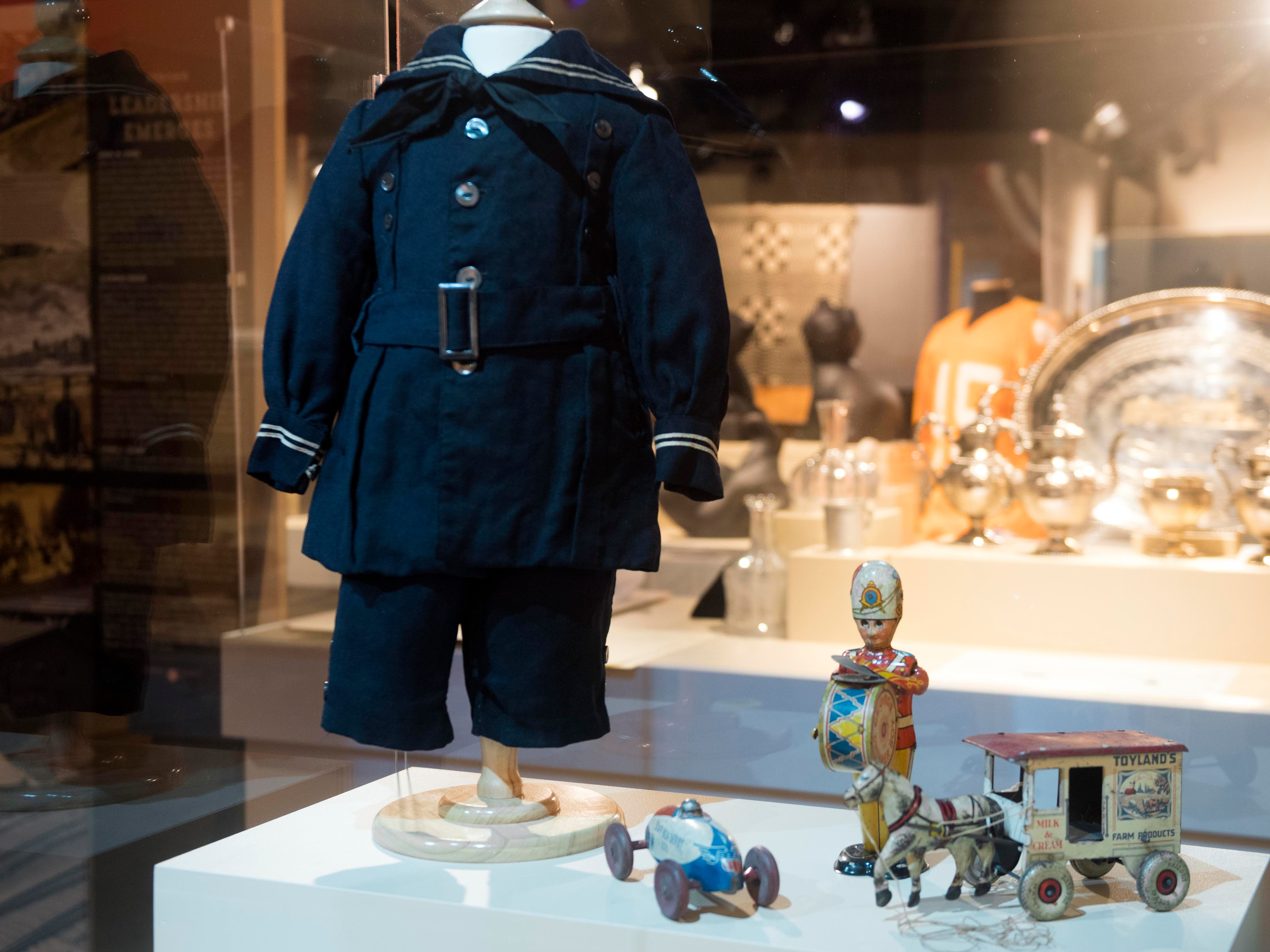 This wool sailor suit was made by Zona McCrary Baldwin of Claiborne County about 1920 for her first-born son, Albert Glenn Baldwin. The little boy would die of diphtheria at age 5. Also shown is a collection of vintage 1930s toys. The items are part of the Museum of East Tennessee History exhibit that looks at its first 25 years. Many of the items are much older than the museum.