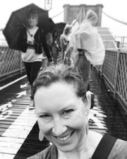 Jennifer, seen here on the Brooklyn Bridge on Sept. 10, is spending her time in NYC soaking up the sights and living in the moment.