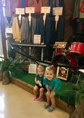 Sisters Marie and Avery Guidry learn about Ville Platte as the birthplace of Louisiana Swamp Pop.