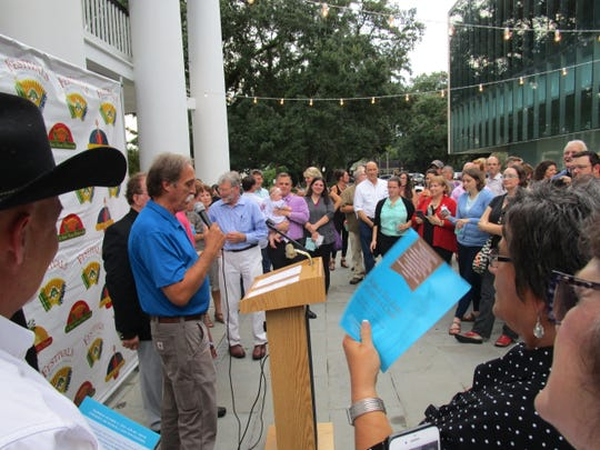 The Festival pin and poster unveiling took place at the HIlliard University Art Museum on Sept. 7.