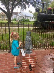 Avery Guidry, 4, learns about the orphan children who came to Louisiana from New York by train. The Louisiana Orphan Train Museum in Opelousas brings history to life with statues outside the building and artifacts inside.
