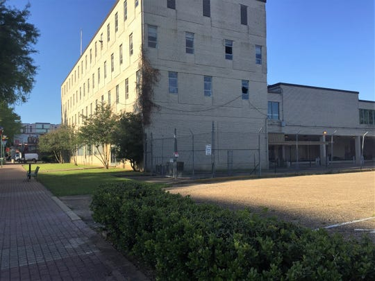 The old federal courthouse on Jefferson Street along with two other buildings and two acres of property will be redeveloped into apartments and commercial space in downtown Lafayette.