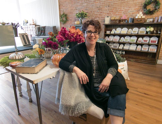 Kelly Lyczkowski, owner of the soon-to-open Dragonfly Emporium in downtown Howell, takes a break Monday, Sept. 10, 2018 from setting up the store.