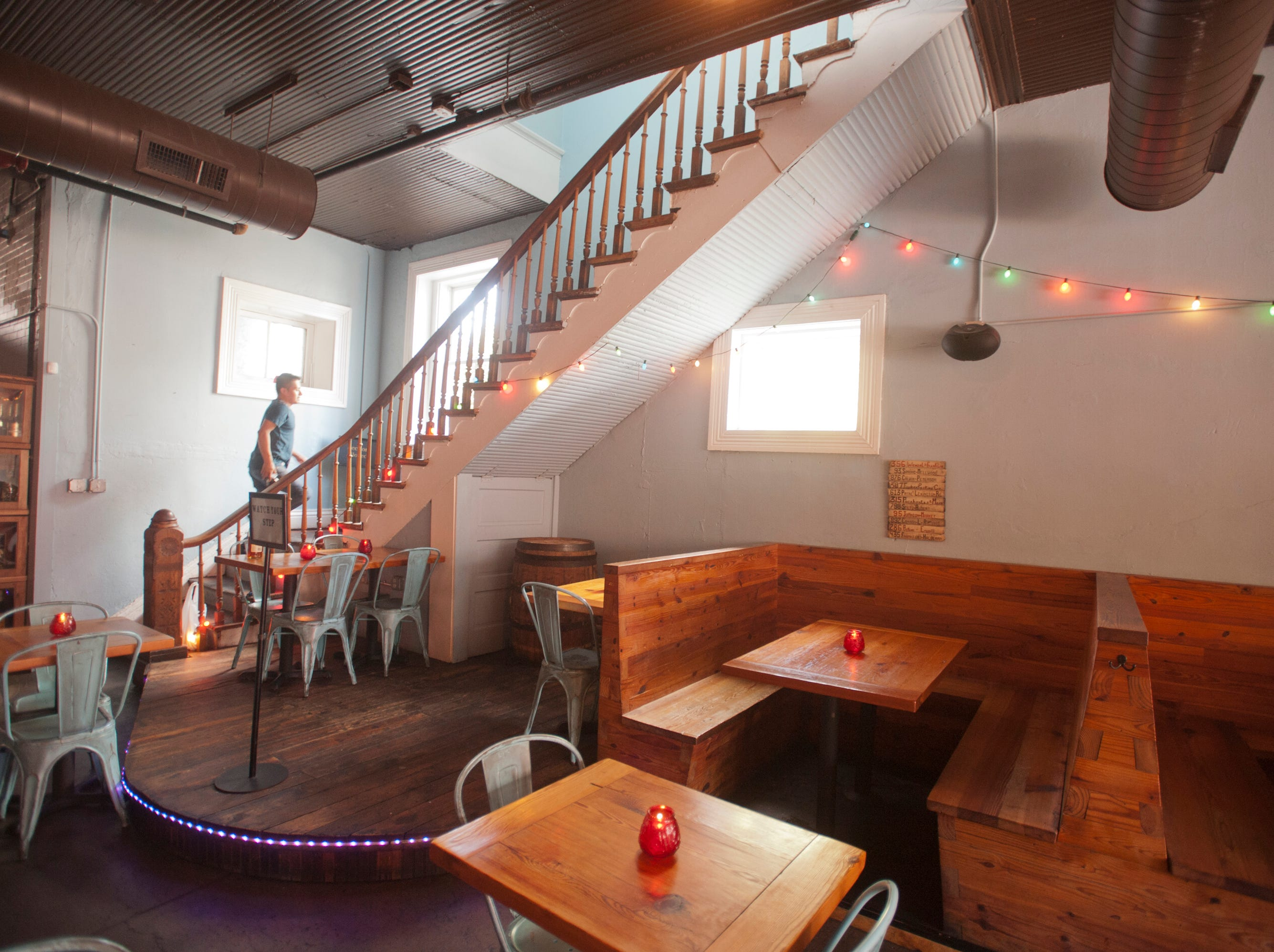 An employee walks up the stairs of the Silver Dollar Bar and Restaurant where patrons can reserve function space.