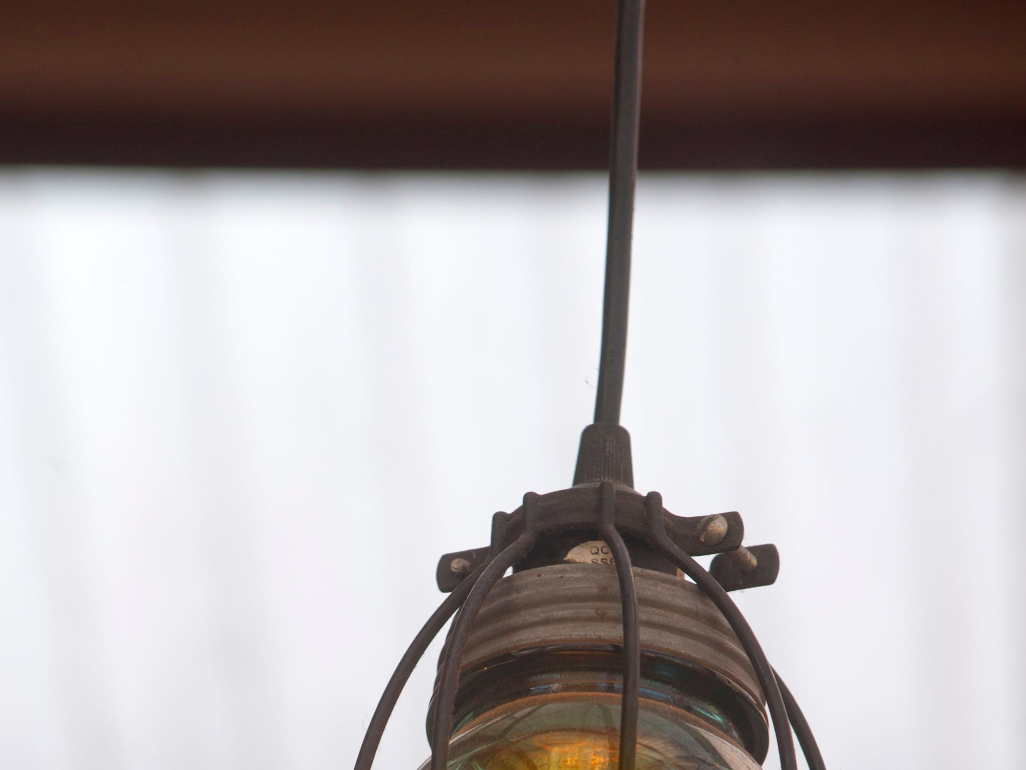 A Ball jar light is suspended over the patio of the Silver Dollar Bar and Restaurant.