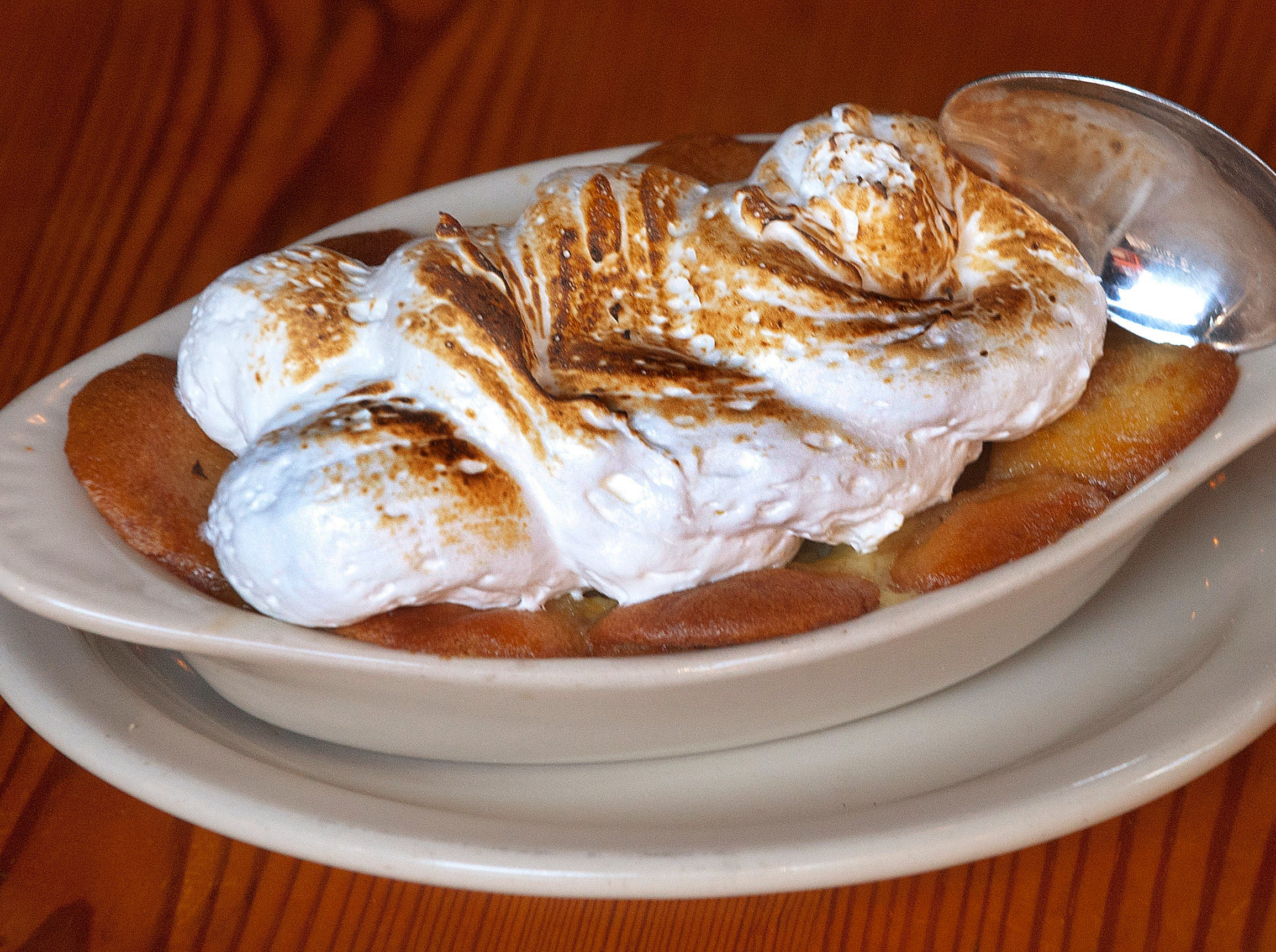 The banana pudding desert at the Silver Dollar Bar and Restaurant is made with a Bourbon custard, vanilla wafers, sliced bananas and topped with a toasted Italian meringue.
