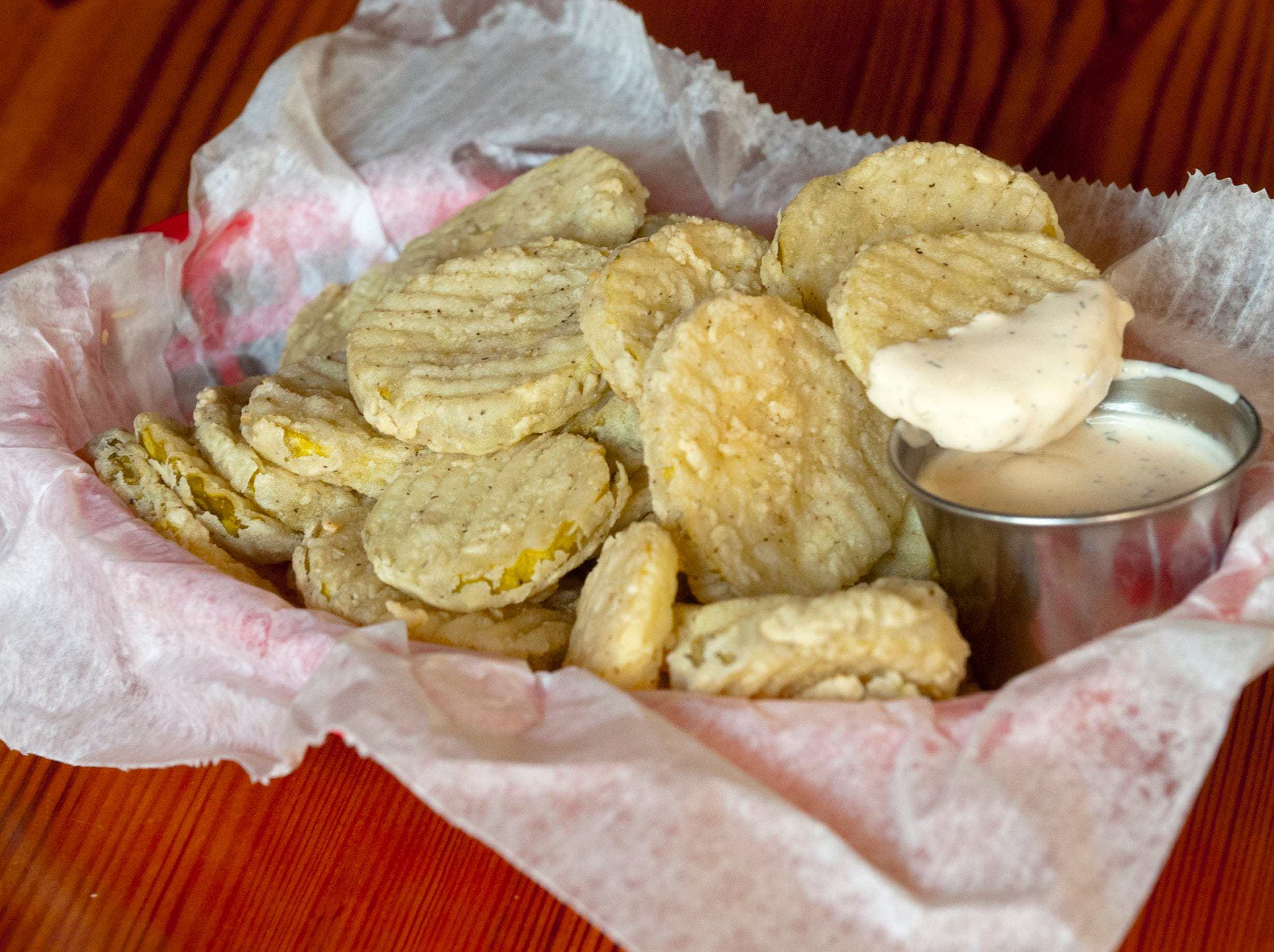 The fried pickles appetizer at the Silver Dollar Bar and Restaurant is served with arbol (tree chili) ranch dip.