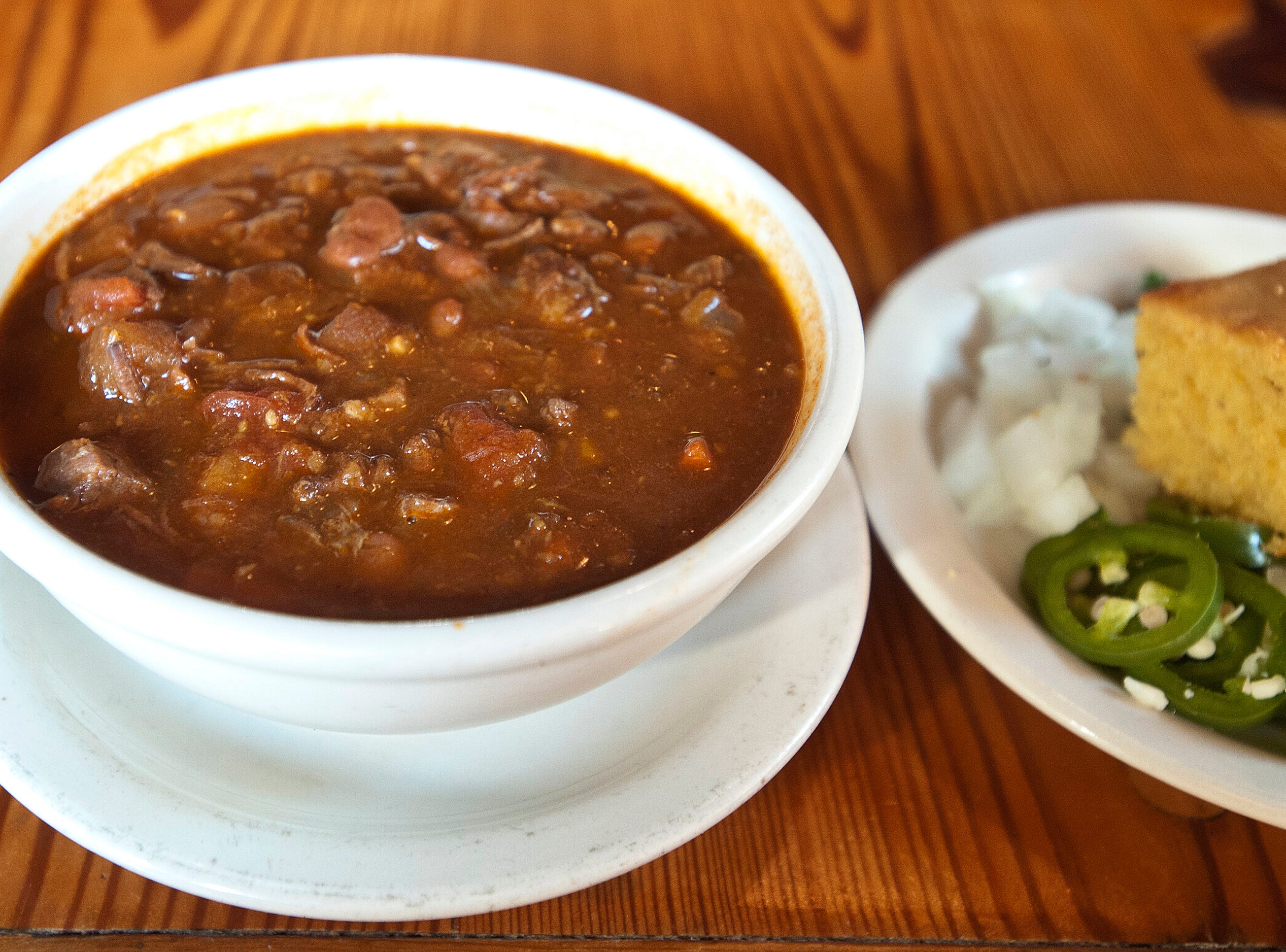 the Silver Dollar Bar and Restaurant' chili con frijoles is brisket mixed with beans and vegetables and served with a side of corn bread, pickled jalepenos, diced white onions, cilantro and white cheddar cheese.