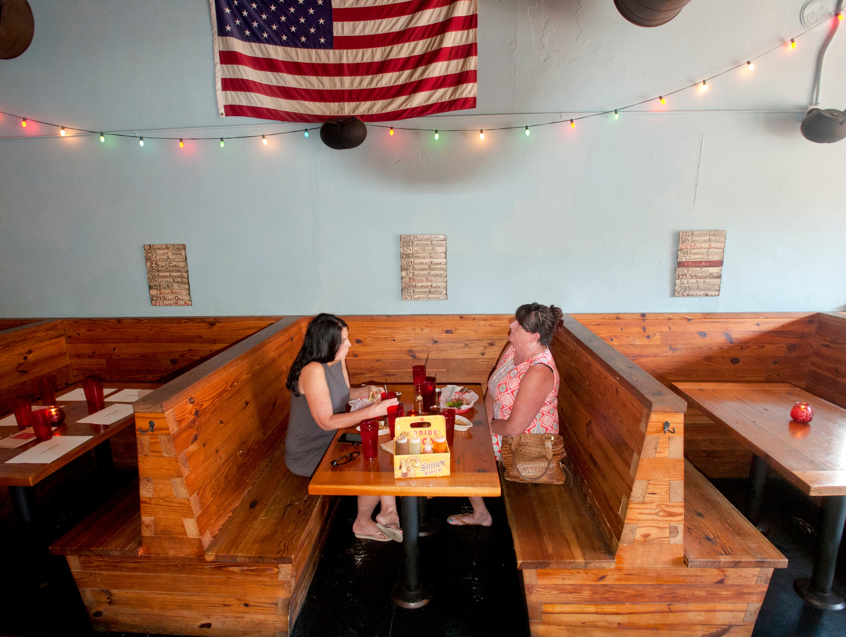 Regular patrons Kim Sickels of Prespect and Terri Trussell of New Albany (In.) eat in the dining room of the Silver Dollar Bar and Restaurant. 