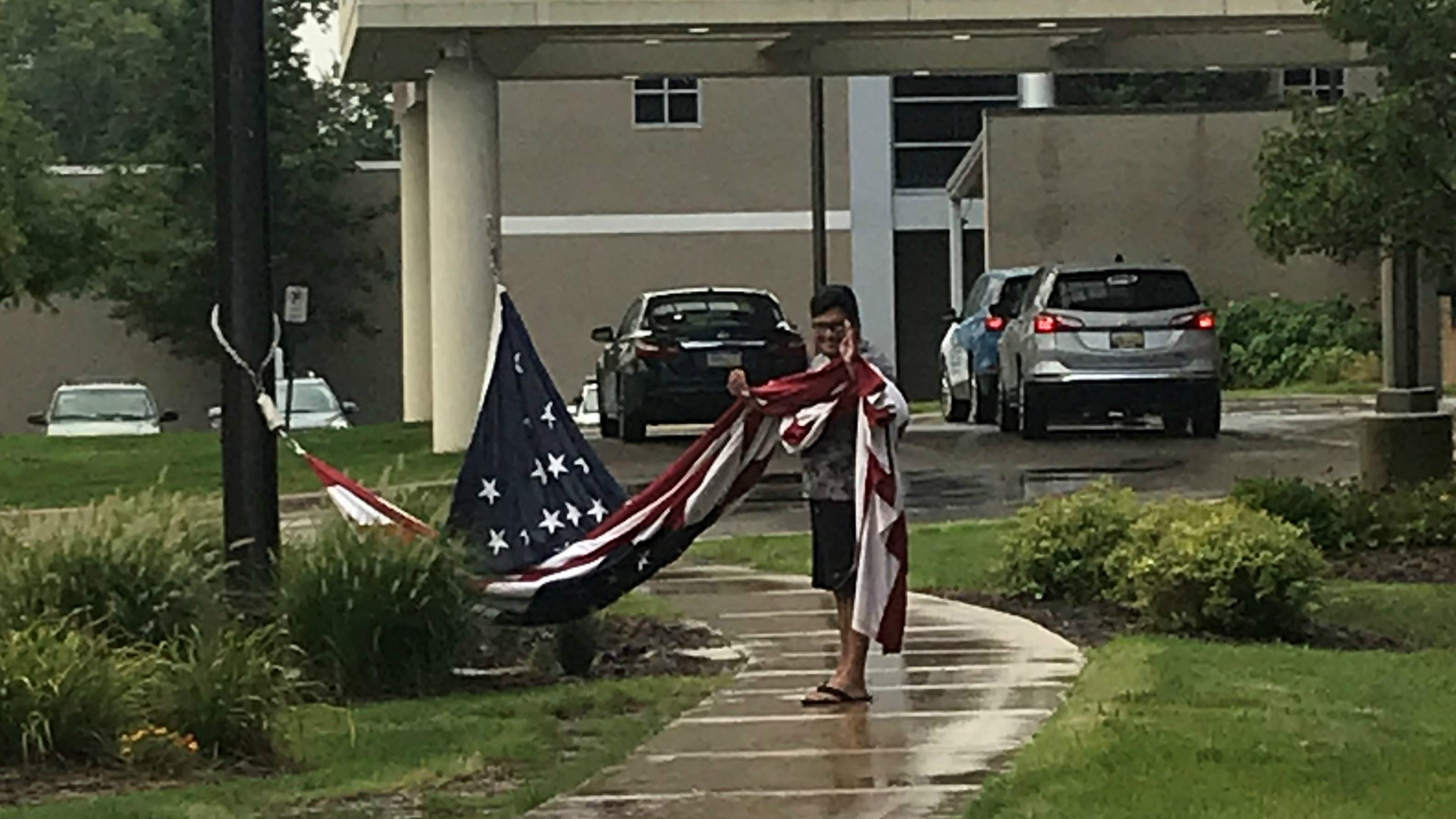Putnam: When the Stars and Stripes fell in the rain, he acted to keep it off the ground