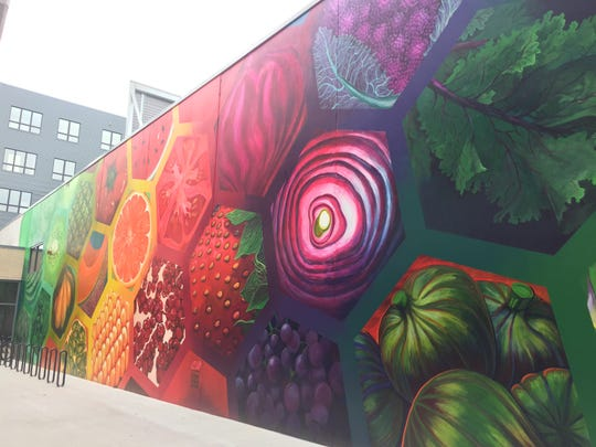 A brightly-colored mural outside the new Bridge Street Market in Grand Rapids.