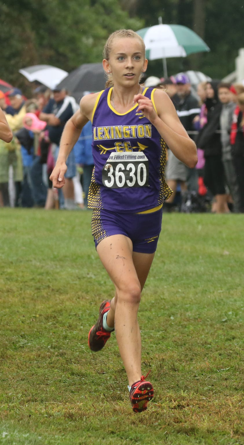 Lexington's Joanna Halfhill crosses the finish line during the Tiffin Cross Country Carnival.