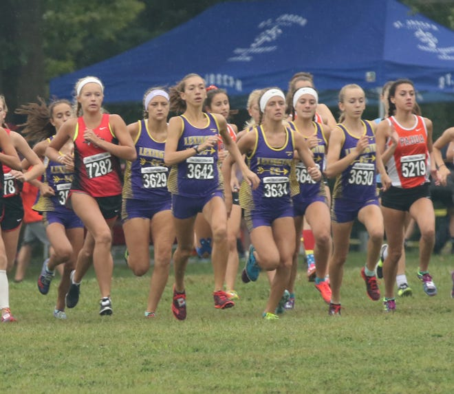 Members of the Lexington girls cross county team run at the starting line of the Tiffin Cross Country Carnival this fall. The team won a state championship last weekend.